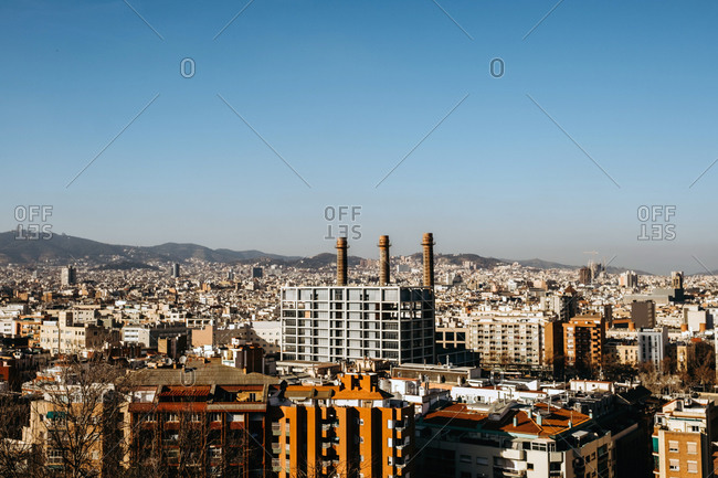 Modern apartment buildings located on streets of Barcelona City against cloudless sky in evening in Spain