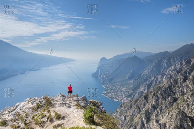 Pregasina, Riva del Garda, Trento Province, Trentino, Italy. Deep view from Punta Larici to Lake Garda with the town Limone sul Garda