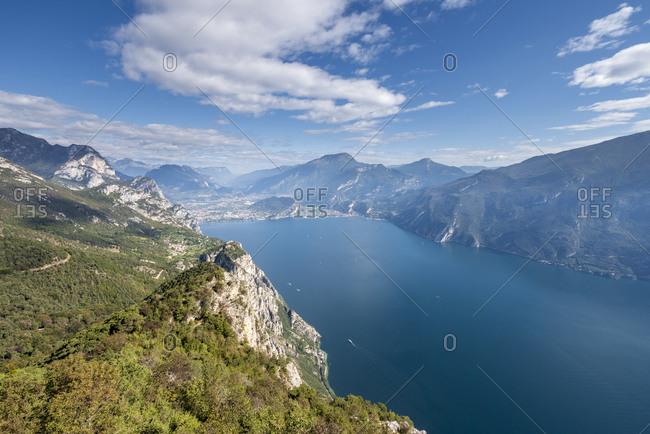 Pregasina, Riva del Garda, Province of Trento, Trentino, Italy. Deep view from Punta Larici to the Lake Garda with the villages Riva del Garda and Torbole sul Garda
