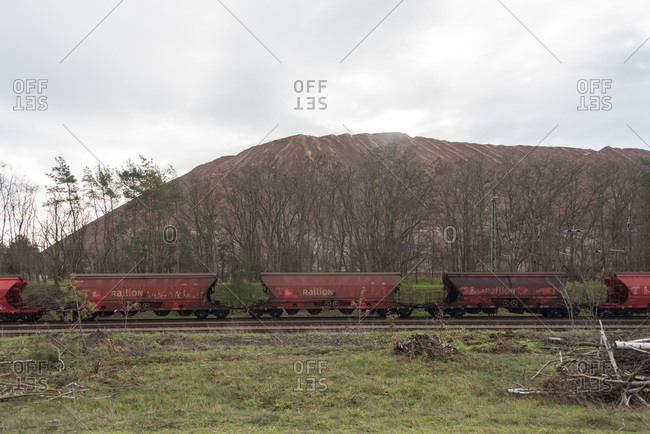 December 9, 2019: Germany, Saxony-Anhalt, Zielitz, view of freight trains and the tailings dump