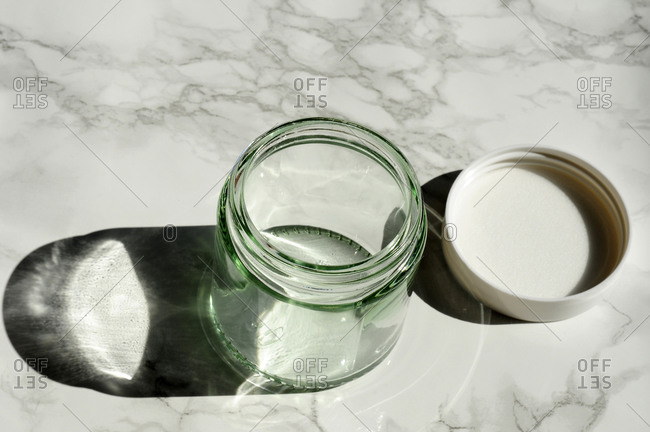Empty glass jar on marble countertop
