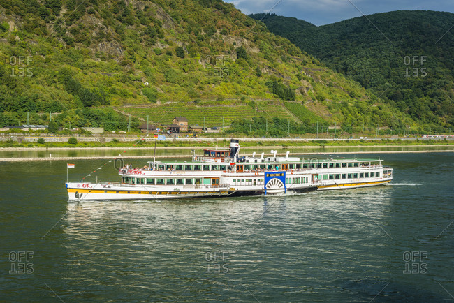 August 28, 2016: Passing by the historic paddle steamer Goethe,, Unesco World Heritage Upper Middle Rhine Valley