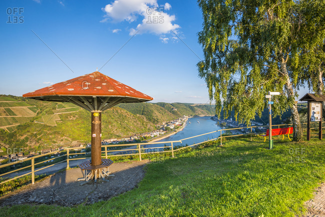 September 11, 2015: Umbrella at the viewpoint over St. Goar, evening mood with pure Rhine romance, part of the Unesco World Heritage Upper Middle Rhine Valley