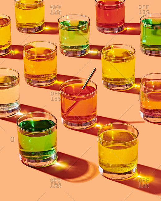 Multiple Glasses with Colorful Liquid in Grid Layout