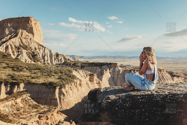 Woman covering mouth as she takes in the view overlooking beautiful canyons