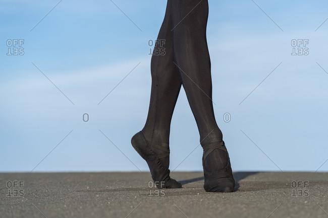 Anonymous male dancer ballet on tiptoe