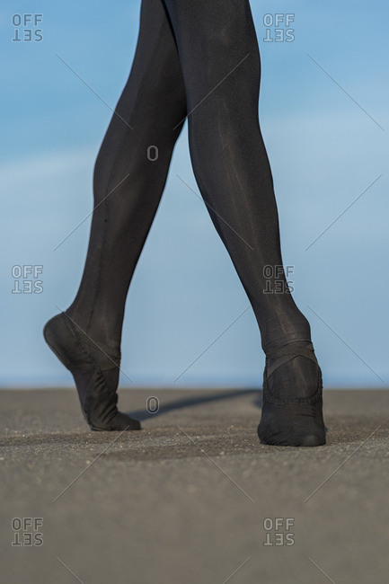 Close up photo of anonymous male dancer ballet on tiptoe