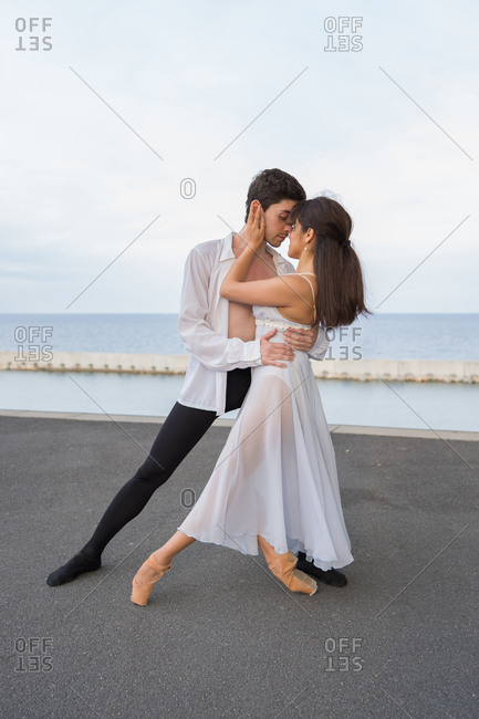 Young passionate dancers dancing outdoors