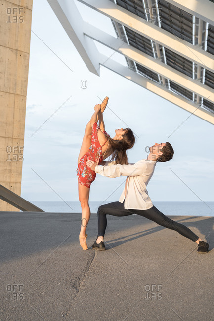 Young couple dancing in the city