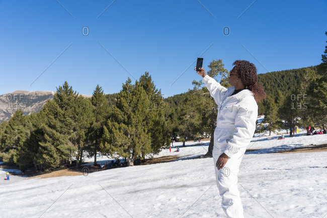 Black woman making a selfie in the snow
