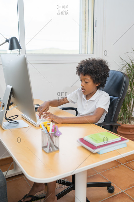 Afro american boy typing on a computer