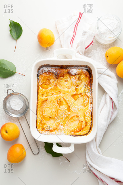 Overhead view of apricot cake on white surface