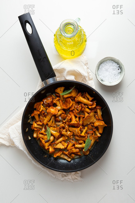 Roasted chanterelle mushrooms with butter in pan