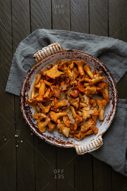 Chanterelle mushrooms in dish on rustic table