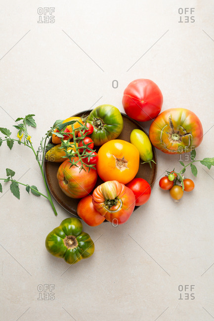 Overhead view of fresh heirloom tomatoes on a plate
