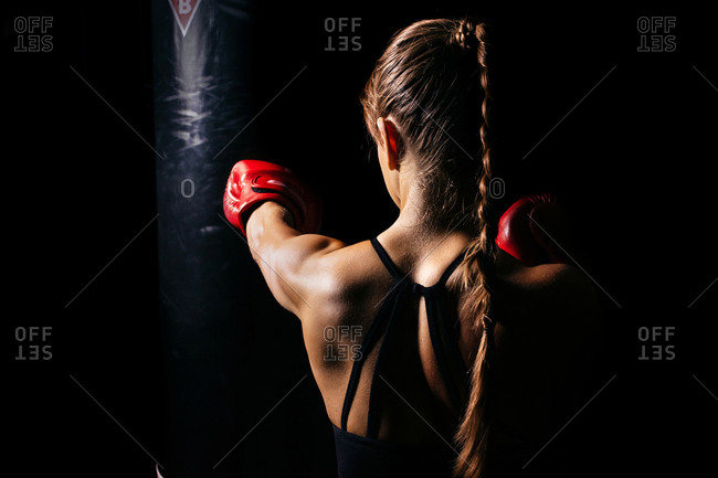 The girl is engaged in boxing
