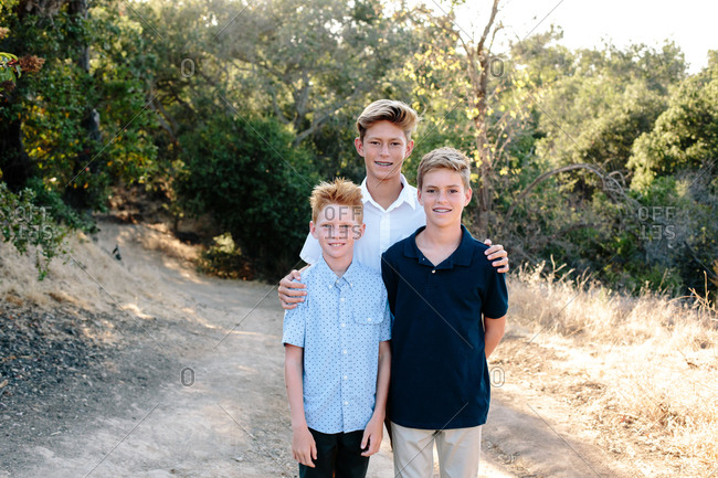 Portrait Of Three Handsome Boys On A Hiking Trail