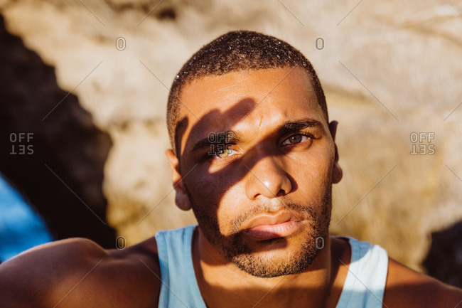 Portrait of man in the shadow of his own hand