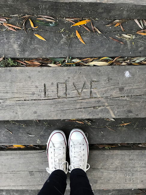 Look from above, Love engraved in wood floor