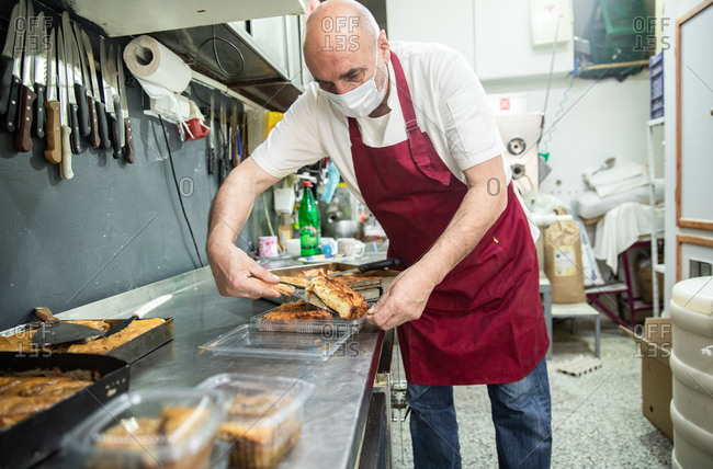Baker Wearing a Mask and Serving Balkan Food in Belgrade, Serbia