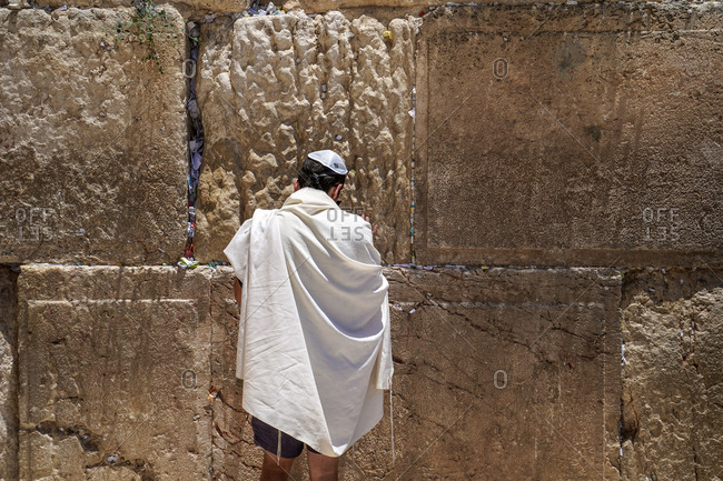 A man is praying in front of the Western Wall, Jerusalem, Israel