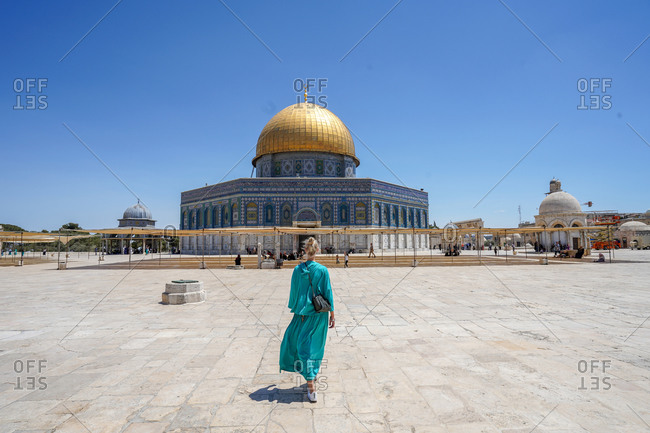 Jerusalem, Jerusalem District, Israel - June 20, 2018: One woman stands in front of the famous Dome of the rock shrine