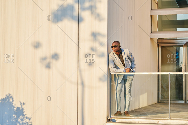 African American businessman at sunset in a building.
