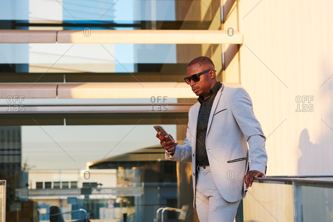 African American businessman with mobile phone on a summer afternoon.