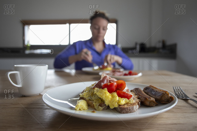 First person view of eating breakfast with someone