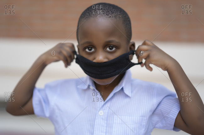 African boy with protective mask to avoid covid19