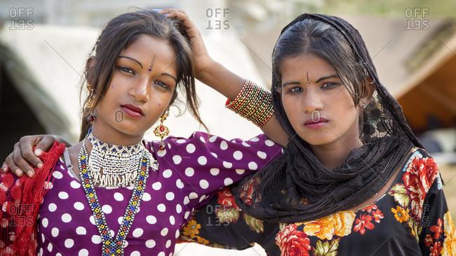 Pushkar, RJ, India - August 31, 2013: Portrait of two nomad girls in Pushkar, Rajasthan, India