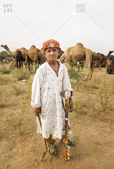 Pushkar, RJ, India - August 31, 2013: Portrait of a child musician in Pushkar, Rajasthan, India