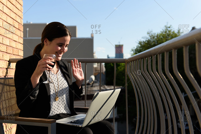 Professional business woman sharing happy hour after work from home