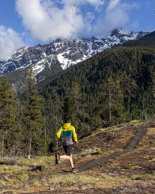 Trail running on a scenic alpine mountain trail in British Columbia.