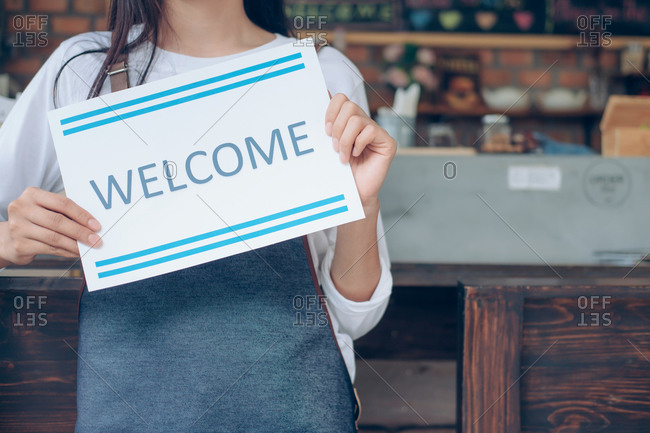 Welcome. Young startup owner small cafe shop.