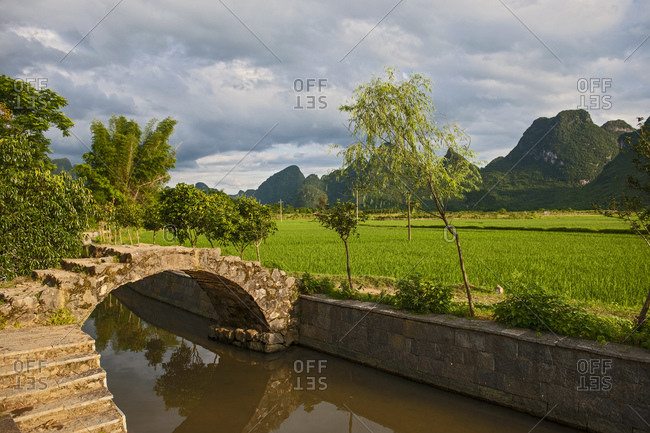 arched pedestrian bridge in rural China close to Yangshuo