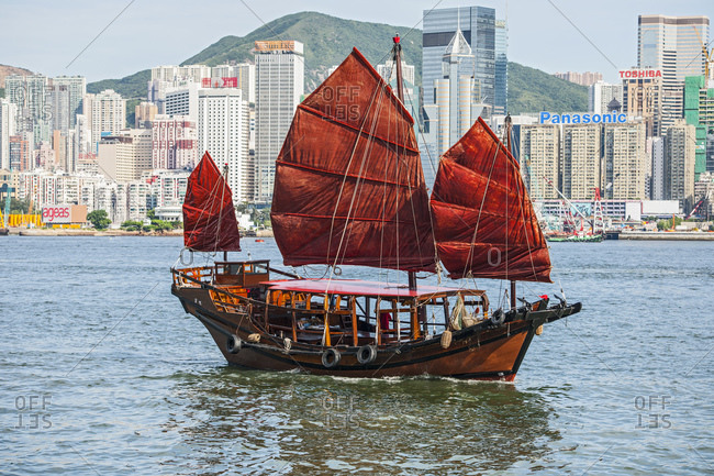 Hong Kong, Hong Kong - June 18, 2015: traditional junk boat at Victoria Harbor in Hong Kong