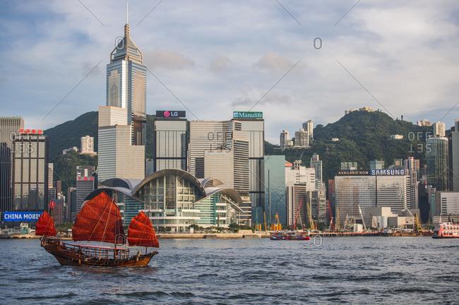 Hong Kong, Hong Kong - June 18, 2015: traditional junk boat at Victoria Harbor in Hong Kong