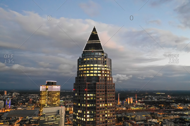 Frankfurt, HE, Germany - October 1, 2018: Circa November 2019: Incredible Aerial Close Up View of Messeturm in Frankfurt am Main, Germany Skyline at Night with City Lights