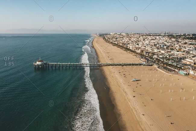 Aerial View over Manhattan Beach in California with Green Blue Water and Blue Sky
