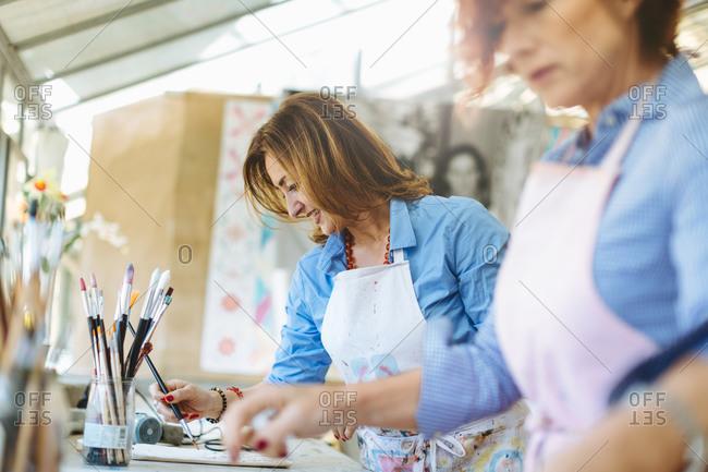 Two women working in creative studio