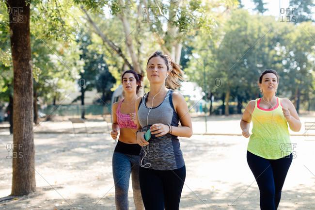Friends jogging in park together