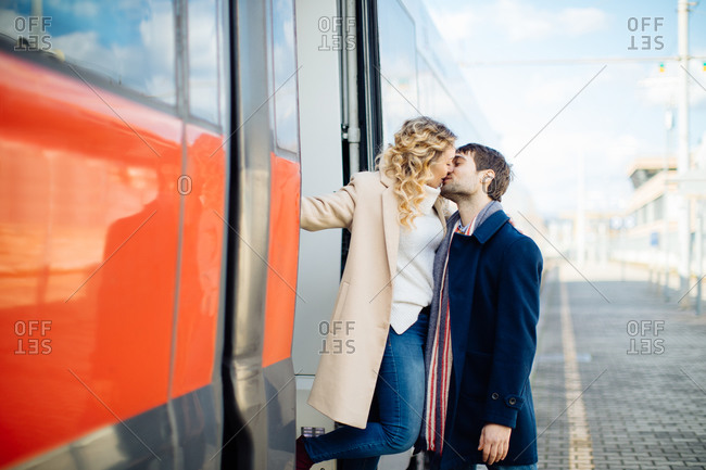 Couple kissing beside train, Firenze, Toscana, Italy