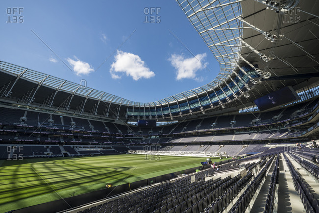 Tottenham , London, United Kingdom - September 12, 2019: Tottenham Hotspur football stadium, empty stands and sunshine on the pitch.