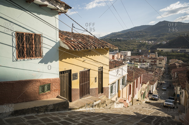 San Gil, Santander, Colombia - January 13, 2020: Street scene, a town with cobbled streets and low houses in a valley in the mountains.