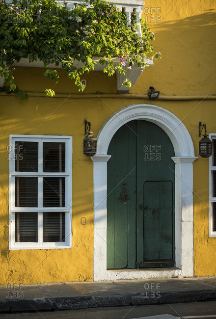 Colorful yellow house wall and green front door in the Old City