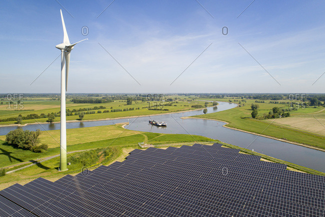 Solar panels and wind turbine near Ijssel river, The Netherlands.