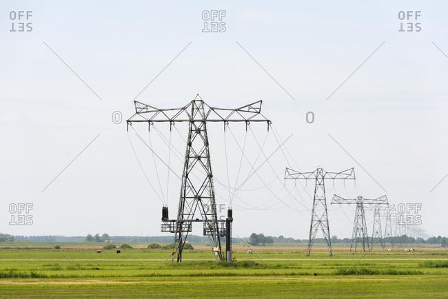 Powerline across fields in Overijssel, The Netherlands.