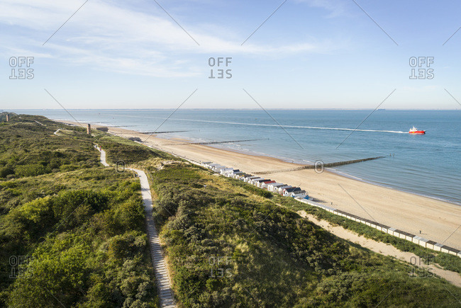 View along dunes and sandy beach between Zoutelande and Vlissingen, The Netherlands.