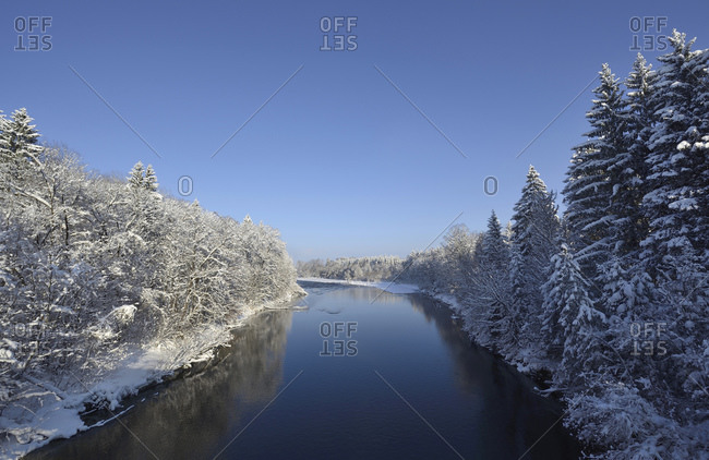 Germany- Bavaria- Geretsried- Clear sky overIsar river in winter